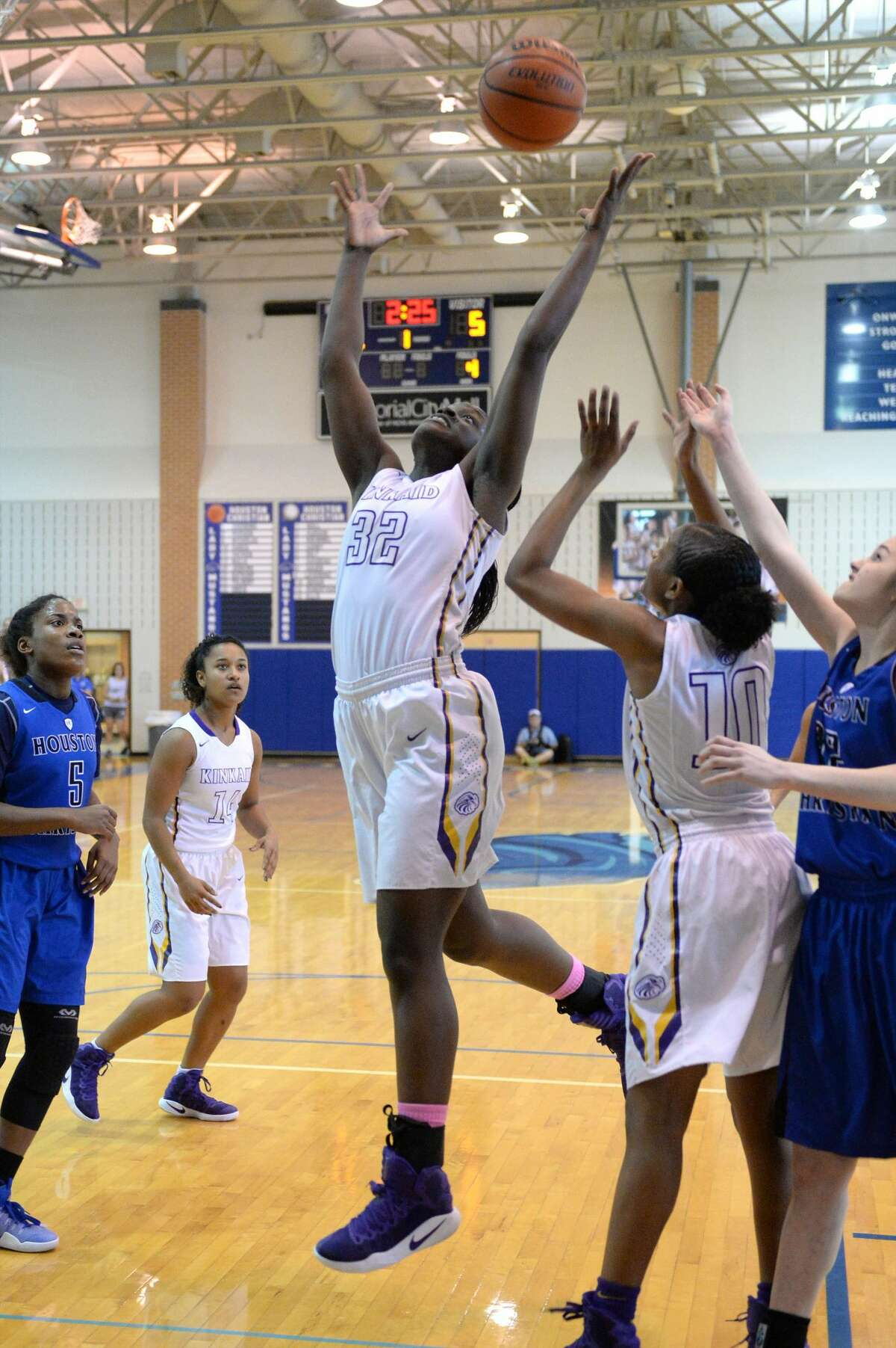 Chinaza Ndee (32) of Kinkaid grabs a rebound during the first half of the girls SPC Championship basketball game between the Kinkaid Falcons and the Houston Christian Mustangs on Saturday February 11, 2017 at Houston Christian High School, Houston, TX.