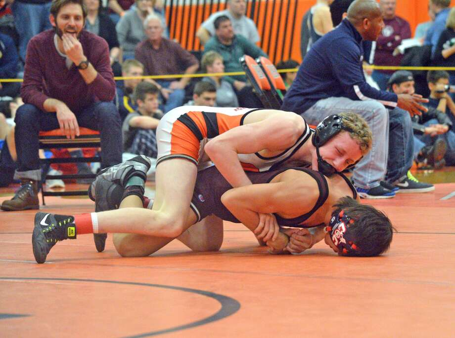 Edwardsville freshman Luke Odom wrestles Matt Ramos of Lockport on Saturday in the 106-pound championship match at the Class 3A Normal Community Sectional.