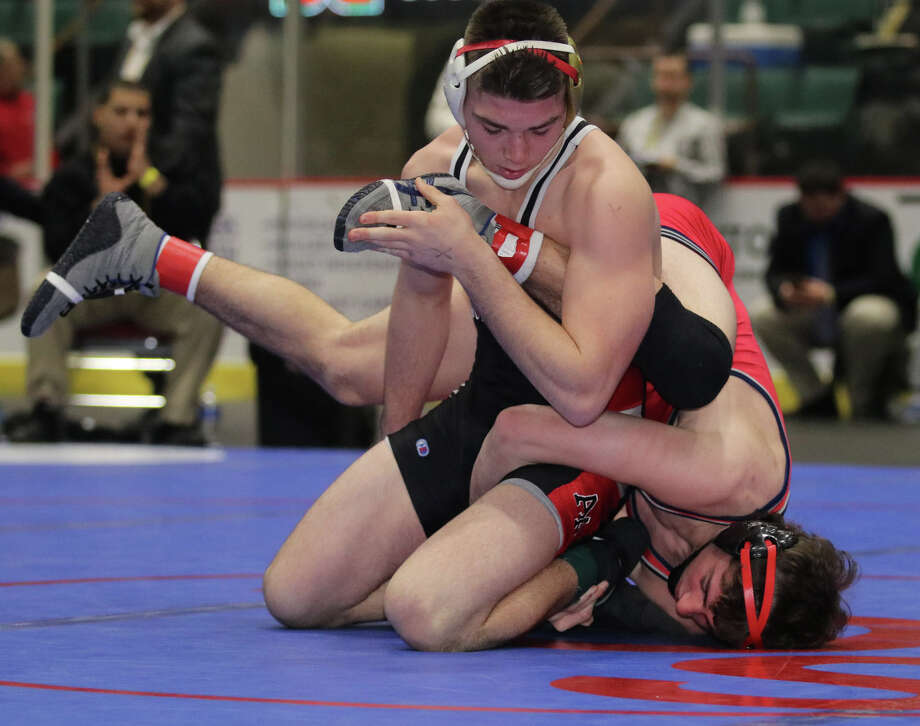 Albany Academy's Kyle Jasenski, top, wrestles to a win at 160 in Div I over Niskayuna's Eoghan Sweeney during the Section II Wrestling Championships Saturday, Feb. 11, 2017 at the Glens Falls Civic Center. (Ed Burke-Special to the Times Union)