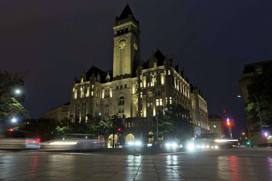 """File photo of the Trump International Hotel, formerly the Old Post Office Pavilion. Brides and grooms who have already gotten married at the hotel are treading carefully in this politcally charged environment. One couple asked that their names not be visible in any photos of their wedding shared online. Others have begun leaving the name """"Trump"""" off invitations, referring to the property instead by its original name, """"the Old Post Office Pavilion."""" Photo: Bloomberg /Bloomberg / © 2016 Bloomberg Finance LP"""