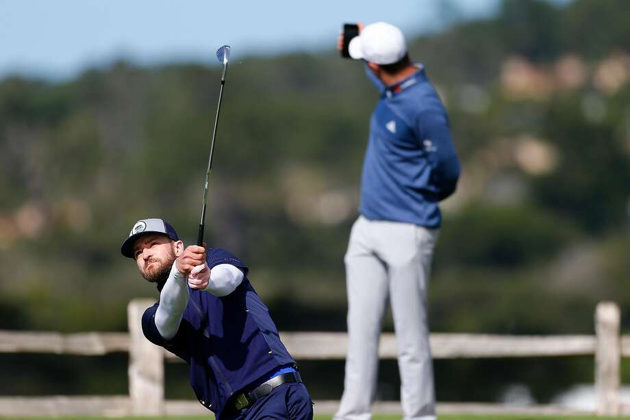 Justin Rose takes a selfie with his partner Justin Timberlake, who just barely misses a hole-in-one on the par-3 No. 7 during the third round at Pebble Beach. Photo: Jonathan Ferrey, Getty Images