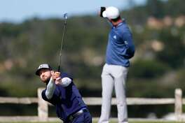 PEBBLE BEACH, CA - FEBRUARY 11:  Justin Rose takes a photo of Justin Timberlake as he just misses a hole-in-one on the seventh hole during Round Three of the AT&T Pebble Beach Pro-Am at Pebble Beach Golf Links on February 11, 2017 in Pebble Beach, California.  (Photo by Jonathan Ferrey/Getty Images)