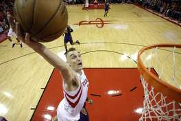 Houston Rockets' Sam Dekker goes up to dunk the ball against the Phoenix Suns during the second half of an NBA basketball game, Saturday, Feb. 11, 2017, in Houston. (AP Photo/David J. Phillip)