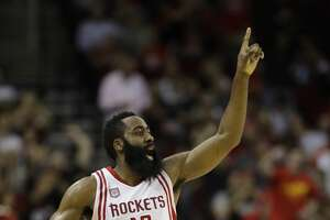 Houston Rockets' James Harden (13) yells to teammates during the second half of an NBA basketball game against the Phoenix Suns, Saturday, Feb. 11, 2017, in Houston. (AP Photo/David J. Phillip)