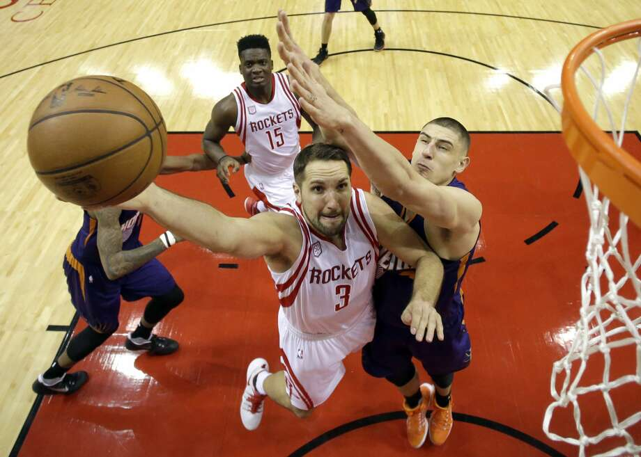 Houston Rockets' Ryan Anderson (3) goes up for a shot as Phoenix Suns' Alex Len defends during the second half of an NBA basketball game, Saturday, Feb. 11, 2017, in Houston. (AP Photo/David J. Phillip) Photo: David J. Phillip/Associated Press