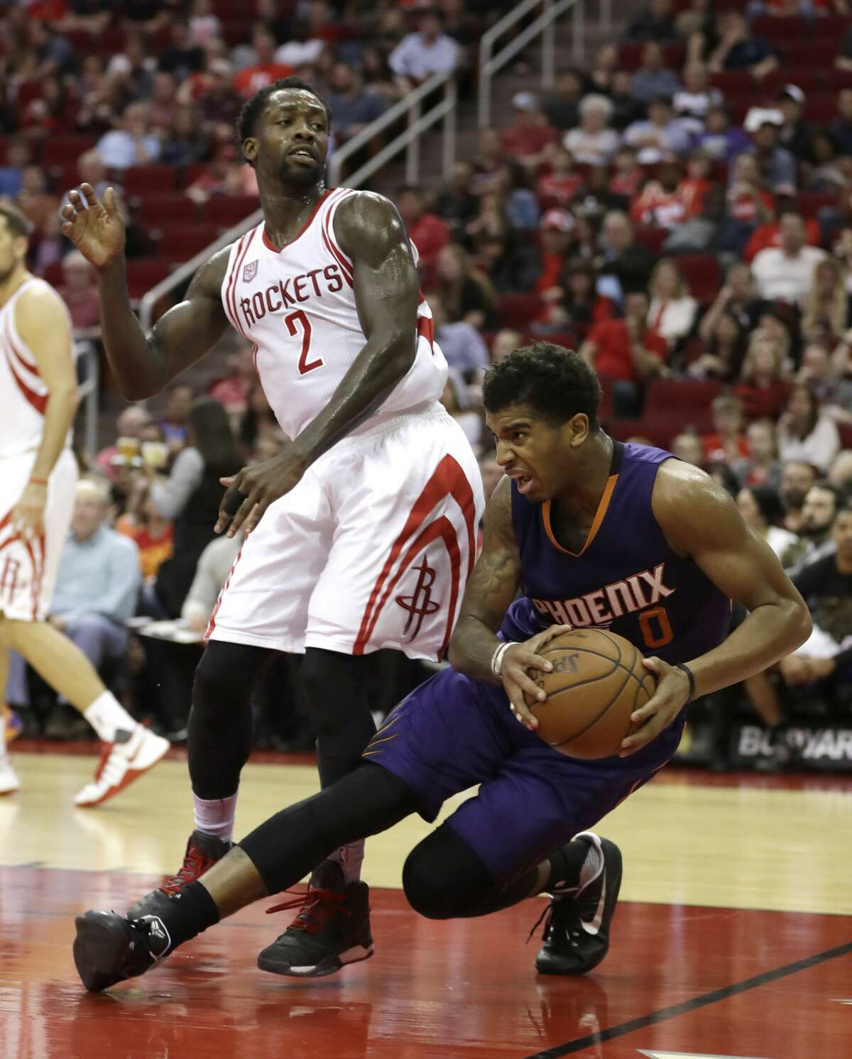 Phoenix Suns' Marquese Chriss (0) is fouled by Houston Rockets' Patrick Beverley (2) during the second half of an NBA basketball game Saturday, Feb. 11, 2017, in Houston. The Rockets won 133-102. (AP Photo/David J. Phillip)