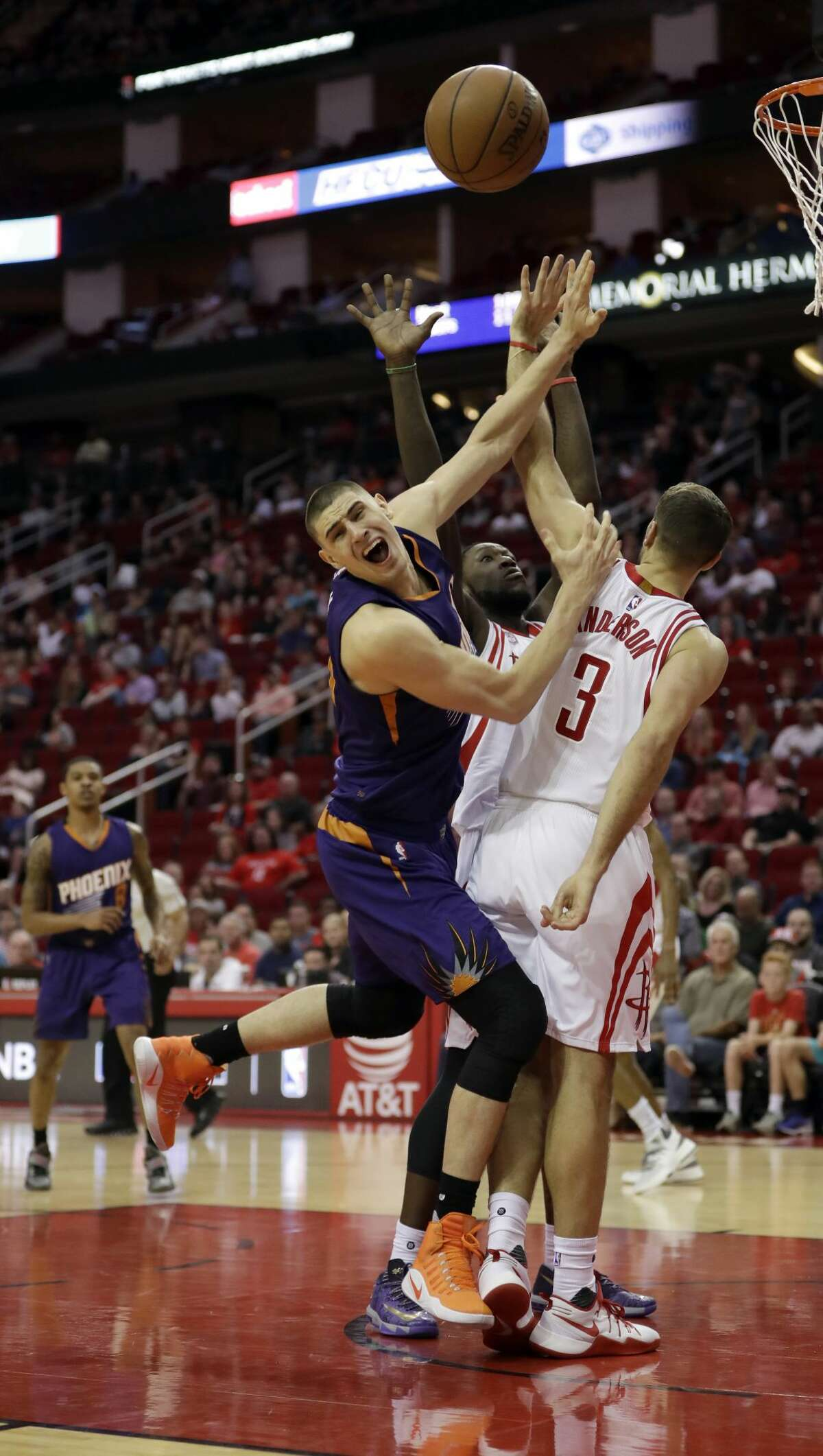 Phoenix Suns' Alex Len, left, is fouled by Houston Rockets' Ryan Anderson (3) during the second half of an NBA basketball game Saturday, Feb. 11, 2017, in Houston. The Rockets won 133-102. (AP Photo/David J. Phillip)