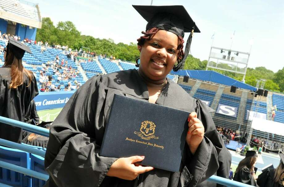 Heather Anderson, formerly of Bridgeport, who is the first in her family to graduate from college, poses with her diploma during the Southern Connecticut State University commencement held at the Connecticut Tennis Center on Friday, May 28, 2010. Photo: Amy Mortensen / Connecticut Post Freelance
