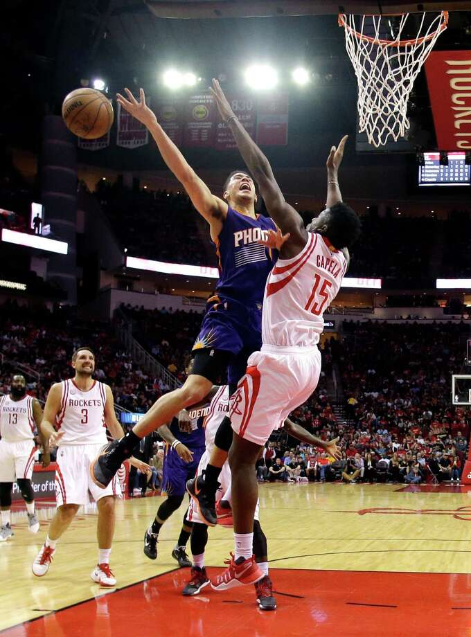 Phoenix Suns' Devin Booker (1) loses the ball as Houston Rockets' Clint Capela (15) defends during the first half of an NBA basketball game, Saturday, Feb. 11, 2017, in Houston. (AP Photo/David J. Phillip) Photo: David J. Phillip, STF / Copyright 2017 The Associated Press. All rights reserved.