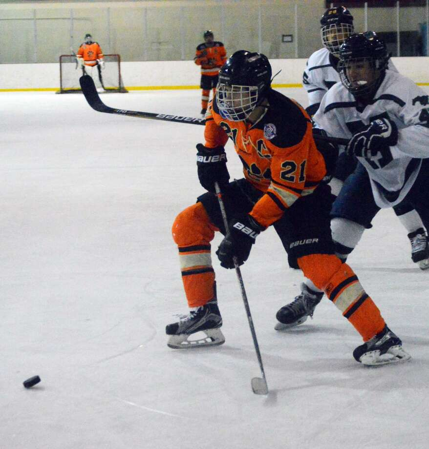 Edwardsville center Carson Lewis scores on a wrist shot in the first period.