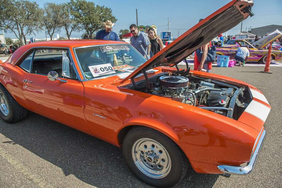 Custom car enthusiasts admire a custom SS 350 Camaro on Saturday, February 11, 2017 at the El Metro Park and Ride during the Pipes and Stripes Car Show. Photo: Danny Zaragoza, Staff Photographer / Laredo Morning Times