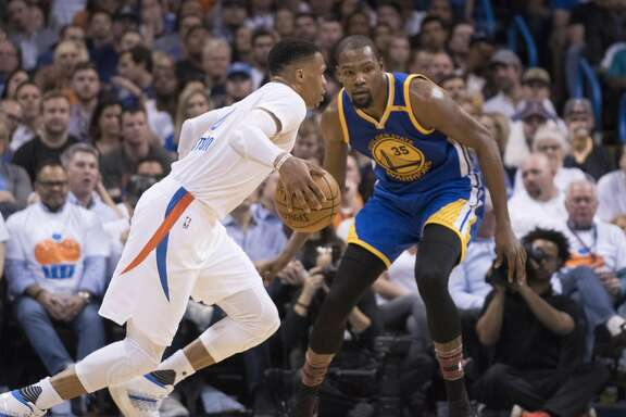 OKLAHOMA CITY, OK - FEBRUARY 11:  Russell Westbrook #0 of the Oklahoma City Thunder drives around Kevin Durant #35 of the Golden State Warriors during the second half of a NBA game at the Chesapeake Energy Arena on February 11, 2017 in Oklahoma City, Oklahoma.   NOTE TO USER: User expressly acknowledges and agrees that, by downloading and or using this photograph, User is consenting to the terms and conditions of the Getty Images License Agreement. (Photo by J Pat Carter/Getty Images)