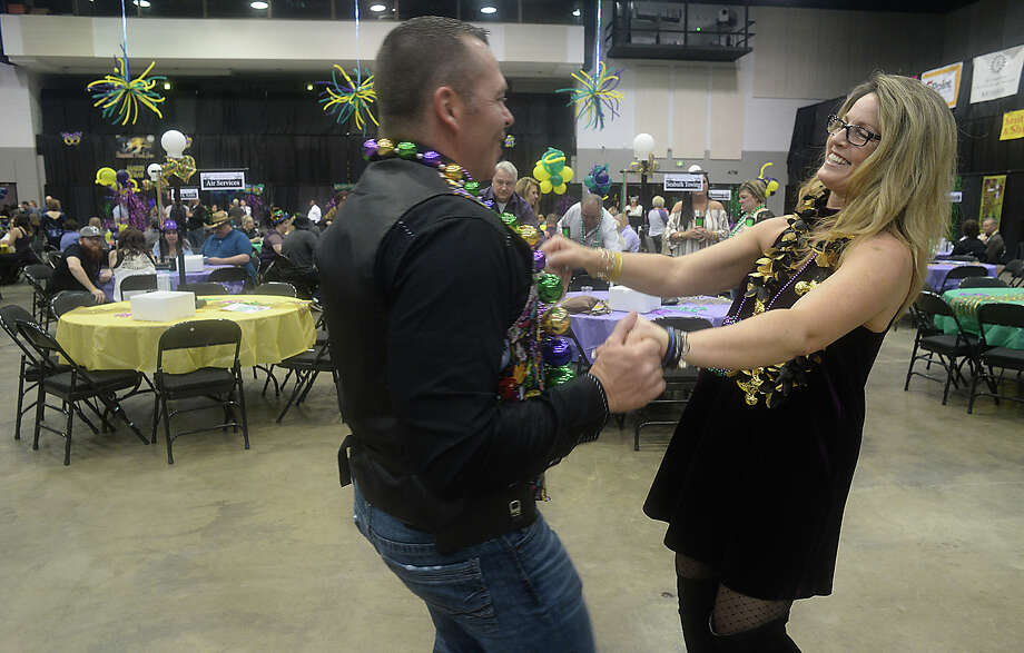 David Archer and Dawn Burris dance to Zydeco music as the party gets under way at the third annual Pardi Gras event Saturday night at the Beaumont Civic Center. Party-goers rang in the festive Mardi Gras season with themed decor and dress, food, music by the local band Champagne Room, and dancing. Proceeds once again benefitted the Southeast Texas Circle of Hope.Photo taken Saturday, February 11, 2017Kim Brent/The Enterprise Photo: Kim Brent