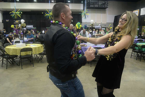 David Archer and Dawn Burris dance to Zydeco music as the party gets under way at the third annual Pardi Gras event Saturday night at the Beaumont Civic Center. Party-goers rang in the festive Mardi Gras season with themed decor and dress, food, music by the local band Champagne Room, and dancing. Proceeds once again benefitted the Southeast Texas Circle of Hope.Photo taken Saturday, February 11, 2017Kim Brent/The Enterprise