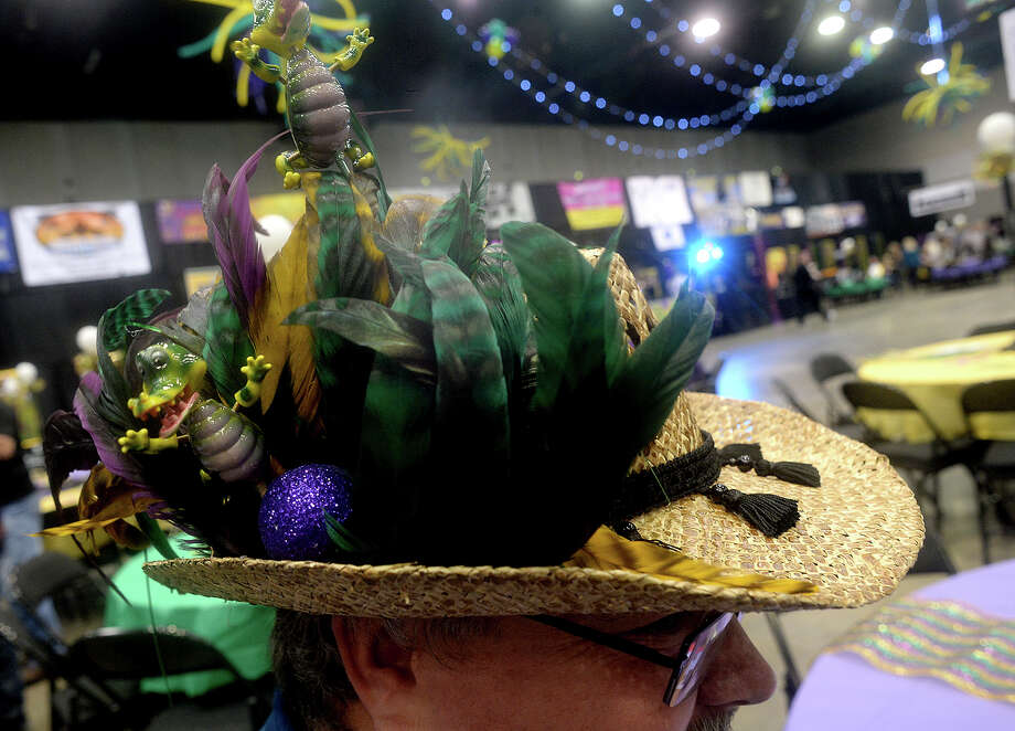 Festive hats were on sale and popular at the third annual Pardi Gras event Saturday night at the Beaumont Civic Center. Party-goers rang in the festive Mardi Gras season with themed decor and dress, food, music by the local band Champagne Room, and dancing. Proceeds once again benefitted the Southeast Texas Circle of Hope. Photo taken Saturday, February 11, 2017 Kim Brent/The Enterprise Photo: Kim Brent
