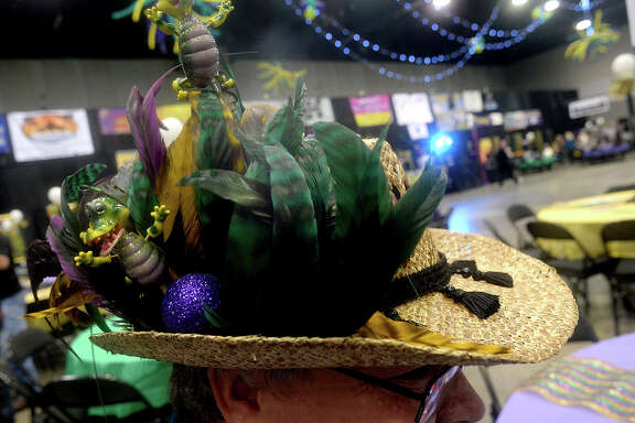 Festive hats were on sale and popular at the third annual Pardi Gras event Saturday night at the Beaumont Civic Center. Party-goers rang in the festive Mardi Gras season with themed decor and dress, food, music by the local band Champagne Room, and dancing. Proceeds once again benefitted the Southeast Texas Circle of Hope. Photo taken Saturday, February 11, 2017 Kim Brent/The Enterprise
