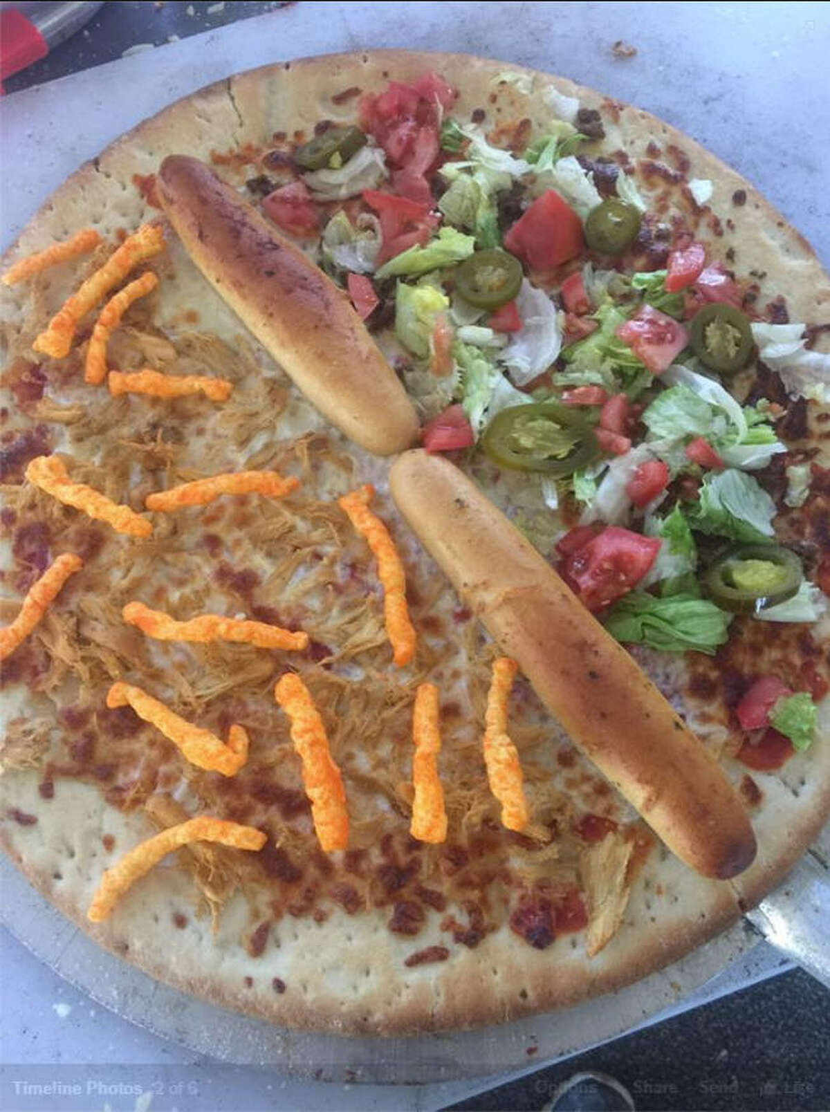 Bread border The Donald Trump-inspired pizza a Peace of Pizza in Midland, Texas, features an all-white bread stick border dividing the Mexican taco pizza side from a white pizza garnished with Cheetos. The restaurant says the Cheetos were inspired by Trump's skin tone.