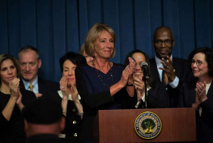 Education Secretary Betsy DeVos is applauded after addressing the staff at the Department of Education on Wednesday, Feb. 8, in Washington.   (AP Photo/Molly Riley)