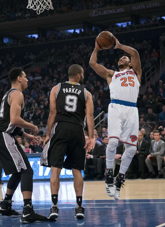 New York Knicks guard Derrick Rose (25) shoots over San Antonio Spurs guard Tony Parker (9) in the first half of an NBA basketball game at Madison Square Garden in New York, Sunday, Feb. 12, 2017. (AP Photo/Craig Ruttle) Photo: Craig Ruttle/Associated Press