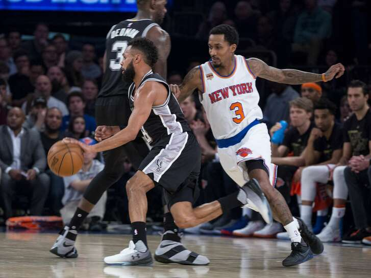 New York Knicks guard Brandon Jennings (3) chases San Antonio Spurs guard Patty Mills in the first half of the team's NBA basketball game at Madison Square Garden in New York, Sunday, Feb. 12, 2017. (AP Photo/Craig Ruttle)