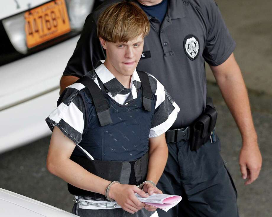 FILE - In this June 18, 2015 file photo, Charleston, S.C., shooting suspect Dylann Roof is escorted from the Cleveland County Courthouse in Shelby, N.C. A federal jury has sentenced Roof to death for killing nine black church members in a racially motivated attack in 2015. (AP Photo/Chuck Burton, File) Photo: Chuck Burton, STF / Copyright 2016 The Associated Press. All rights reserved.