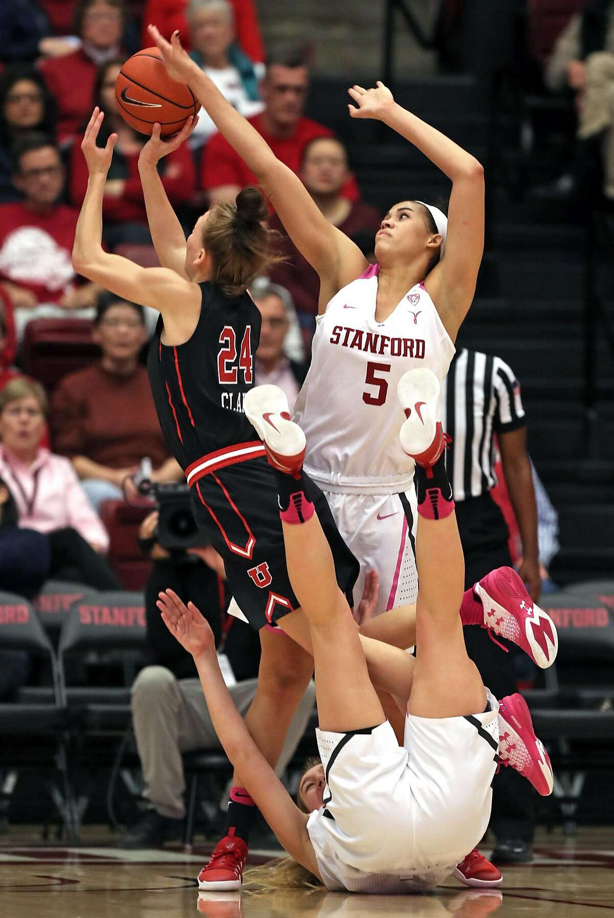 Stanford's Brittany McPhee (on floor) and Kaylee Johnson (5) double team Utah's Tilar Clark in 2nd quarter during PAC 12 Women's basketball game at Maples Pavilion in Stanford, Calif., on Sunday, February 12, 2017.