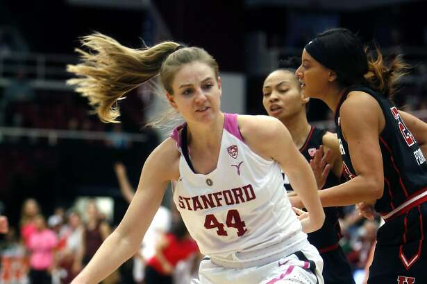 Stanford's Karlie Samuelson (44) drives to the basket past Utah's Daneesha Provo and Kiana Moore in 2nd quarter during PAC 12 Women's basketball game at Maples Pavilion in Stanford, Calif., on Sunday, February 12, 2017.