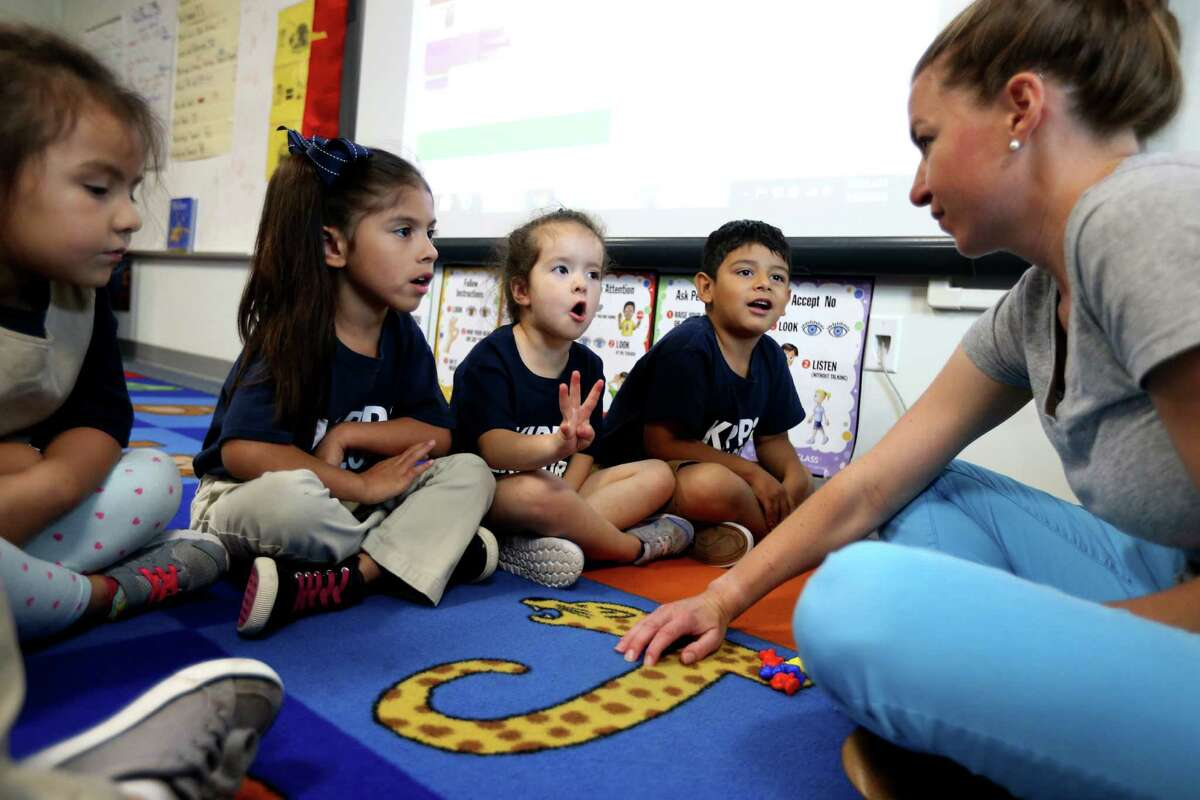 Pre-k 4 teacher Margaret Leiby teaches addition and subtraction to Kimberly Hernandez, 4, Layla Garcia, 5, Sophia Treviño, 5, and Cyrus Miranda, 4, at KIPP Explore Academy, Thursday, May 12, 2016, in Houston, Texas.