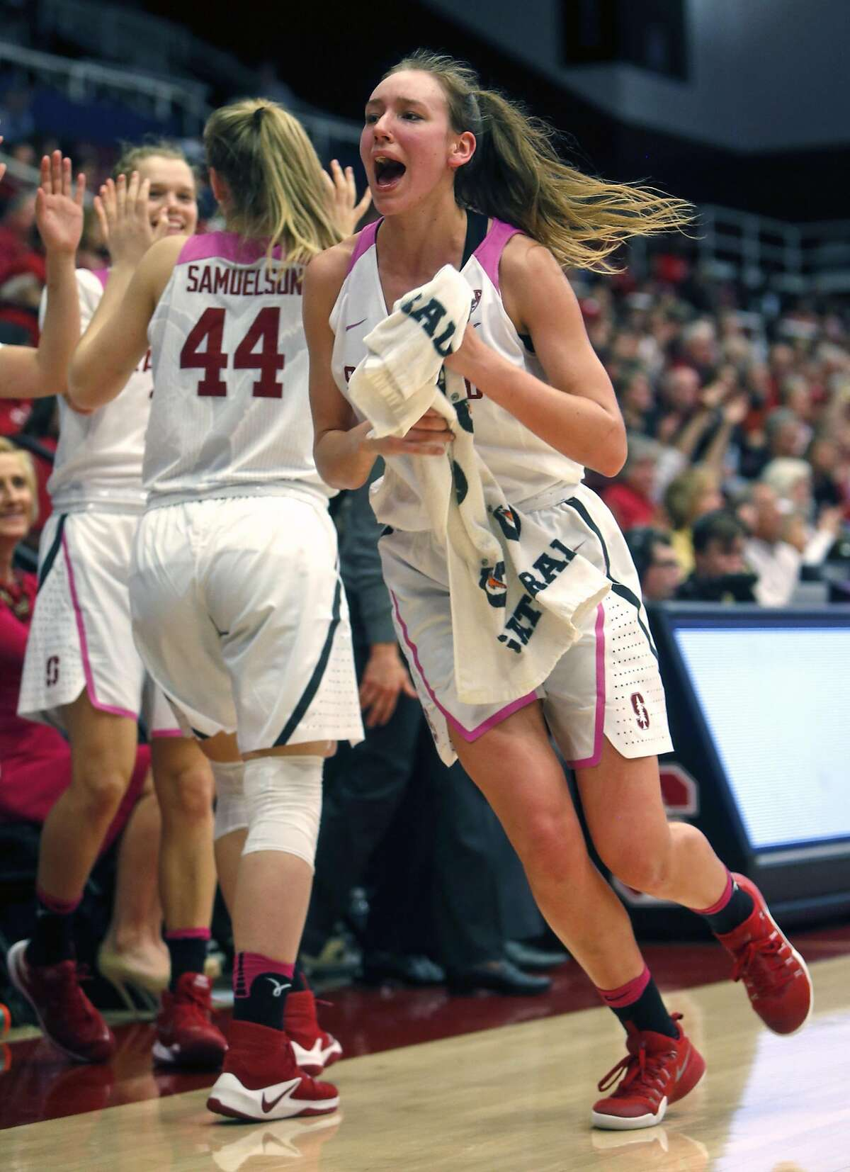 Stanford's Alanna Smith, Brittany McPhee and Karlie Samuelson (44) celebrate a 3-pointer in 4th quarter of Cardinal's 87-51 win over Utah during PAC 12 Women's basketball game at Maples Pavilion in Stanford, Calif., on Sunday, February 12, 2017.