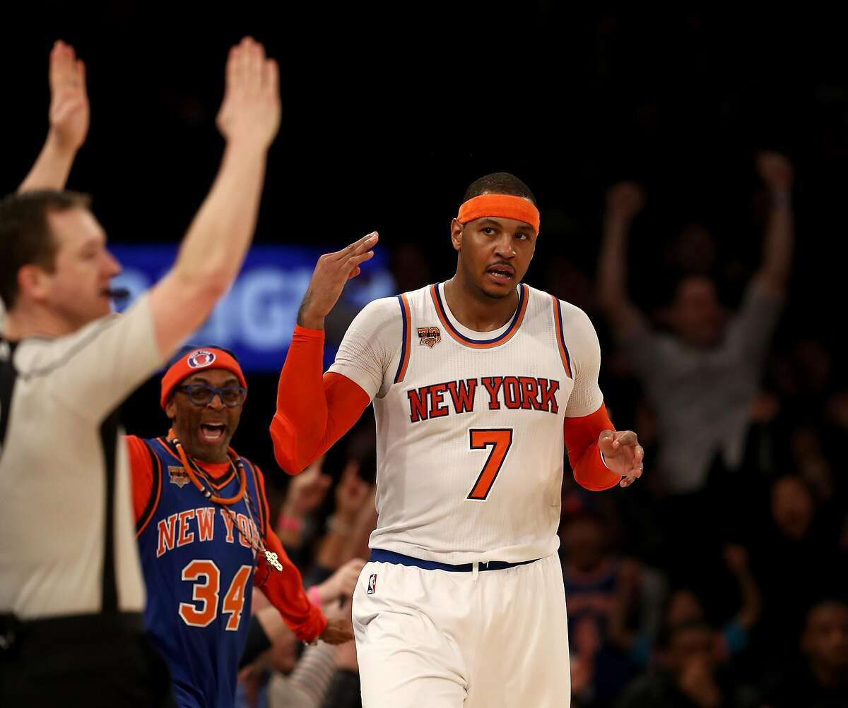 NEW YORK, NY - FEBRUARY 12: Carmelo Anthony #7 of the New York Knicks celebrates his three point shot in the final minutes of the game against the San Antonio Spurs at Madison Square Garden on February 12, 2017 in New York City. NOTE TO USER: User expressly acknowledges and agrees that, by downloading and or using this Photograph, user is consenting to the terms and conditions of the Getty Images License Agreement (Photo by Elsa/Getty Images)