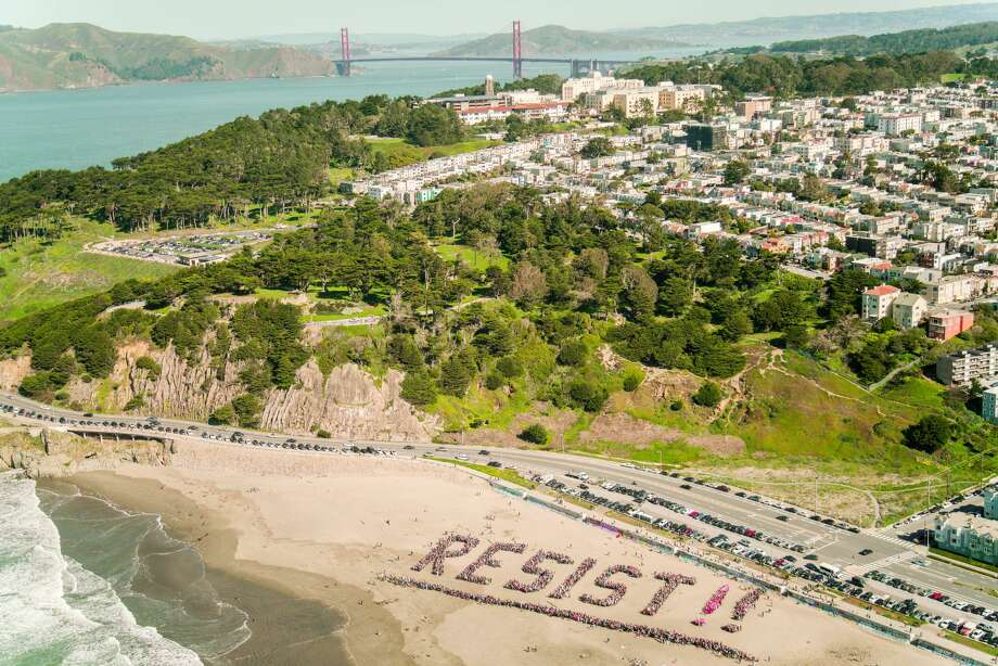 "Protesters gather to spell out ""Resist!!"" on Ocean Beach in San Francisco on Jan. 11, 2017. Photo: Stefan Ruenzel"