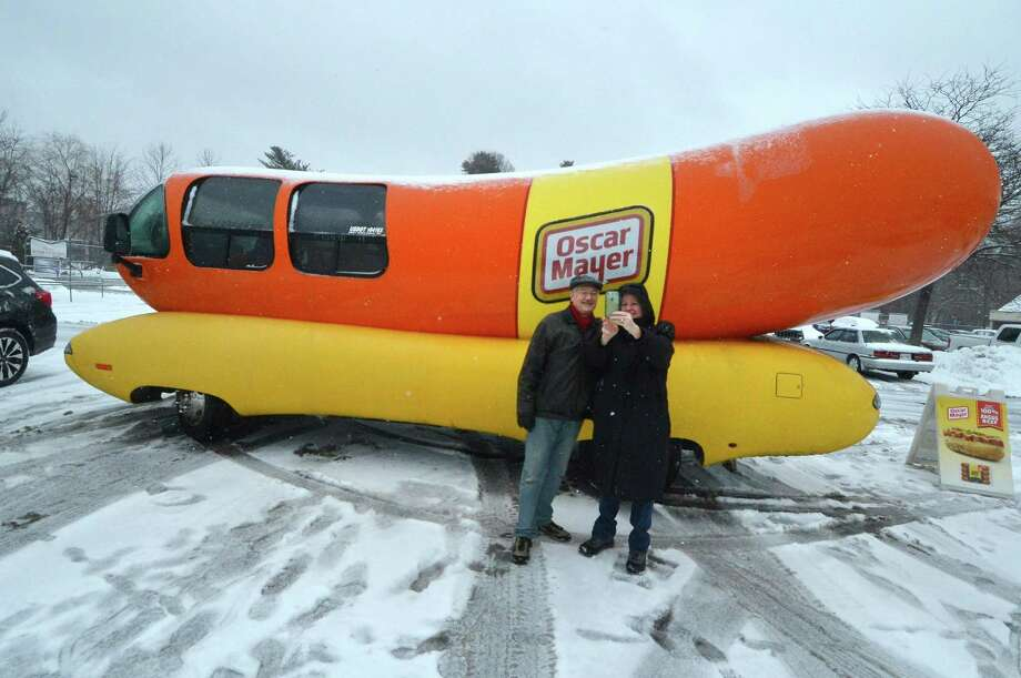 Colleen and Stuart Rumsey from Norwalk take a selfie of themselves and the Oscar Mayer Wiener Mobile, during Sunday's snowstorm. The Weiner Mobile was on view at the Stop and Shop Plaza on Main Ave. Sunday February 13, 2017 in Norwalk Conn. Photo: Alex Von Kleydorff / Hearst Connecticut Media / Connecticut Post