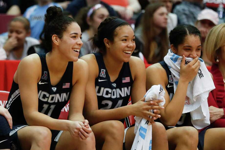 Connecticut's Kia Nurse (11), Napheesa Collier (24), and Gabby Williams, right, smile on the bench in the second half of the team's NCAA college basketball game against Cincinnati, Tuesday, Feb. 7, 2017, in Cincinnati. Connecticut won 96-49. (AP Photo/John Minchillo) Photo: John Minchillo, STF / AP