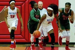 Oak Ridge guard Alecia Whyte (21) starts a fast break during the second quarter of a District 12-6A high school girls basketball game at Oak Ridge High School Tuesday, Jan. 17, 2017, in Conroe. Oak Ridge defeated The Woodlands 66-36.