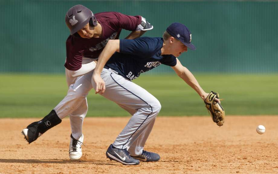 Magnolia base runner Adam Nguyen reaches third base as he collides with Kingwood third baseman Sam Friday during the second inning of a high school baseball scrimmage Saturday, Feb. 11, 2017, in Magnolia. Photo: Jason Fochtman/Houston Chronicle