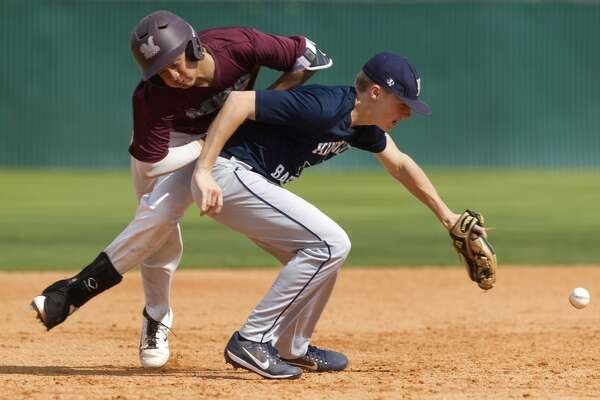 Magnolia base runner Adam Nguyen reaches third base as he collides with Kingwood third baseman Sam Friday during the second inning of a high school baseball scrimmage Saturday, Feb. 11, 2017, in Magnolia.