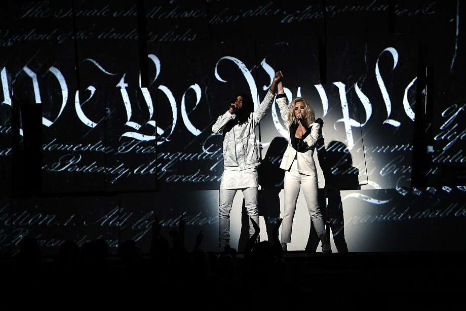 "Skip Marley (left) and Katy Perry, who wore a ""Persist"" armband and Planned Parenthood lapel pin, wrap up their performance with the words of the preamble to the U.S. Constitution dramatically scrolling up behind them at the 2017 Grammy Awards. Photo: Kevork Djansezian, Getty Images"