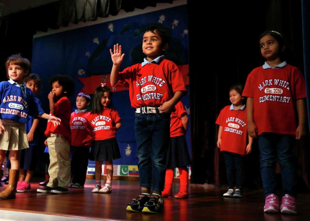 Pre-K student Shounak Tambi performs the grand opening of Mark White Elementary in December.