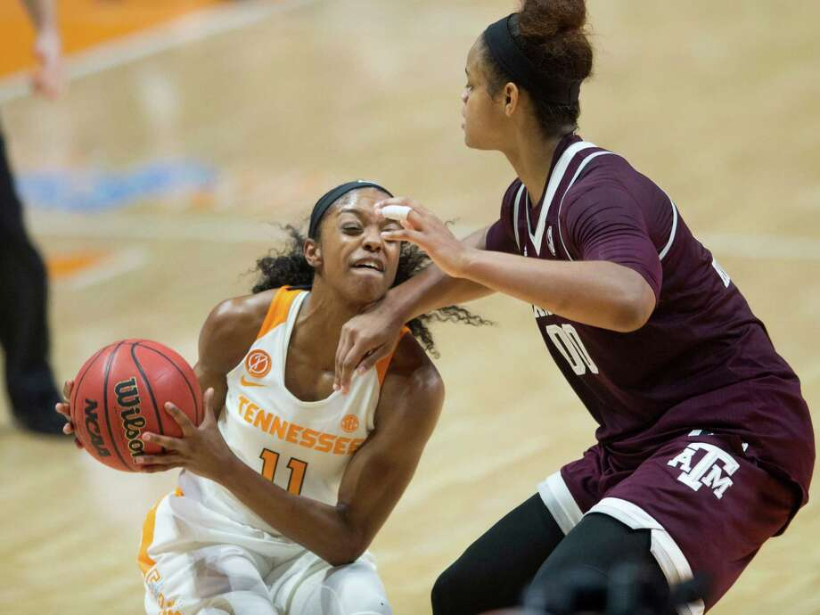 Tennessee's Diamond DeShields pays a price as she tries to make a move on Texas A&M's Khaalia Hillsman, who complemented her good defense with 10 points and 15 rebounds in the Aggies' 61-59 victory over the No. 24 Lady Vols at Knoxville, Tenn., on Sunday. DeShields, who was averaging 18.5 points per  game, scored eight points on 4-of-12 shooting. Photo: Saul Young, MBR / AP 2017