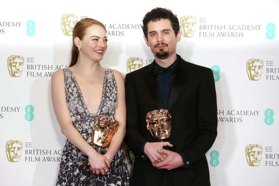 "Actress Emma Stone with her BAFTA award for Best Actress and director Damien Chazelle with his BAFTA award for Best Director both for the film ""La La Land' pose backstage at the British Academy Film Awards in London, Sunday, Feb. 12, 2017. (Photo by Joel Ryan/Invision/AP) Photo: Joel Ryan, INVL / Invision"