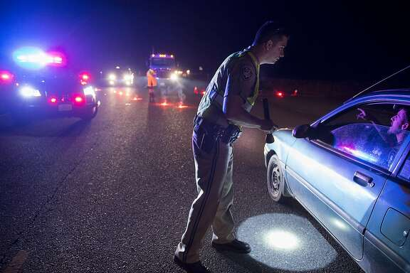 California Highway Patrol officer Ken Weckman directs traffic as residents evacuate Marysville, Calif., Sunday, Feb. 12, 2017. Thousands of residents of Marysville and other Northern California communities were told to leave their homes Sunday evening as an emergency spillway of the Oroville Dam could fail at any time unleashing flood waters from Lake Oroville, according to officials from the California Department of Water Resources. (Paul Kitagaki Jr./The Sacramento Bee via AP)