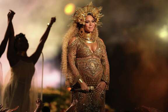 BEST: Beyoncé, pregnant with twins, stole the show in an ethereal golden gown by Peter Dundas, former creative director for Roberto Cavalli. She topped it off with a gold madonna-esque headpiece.