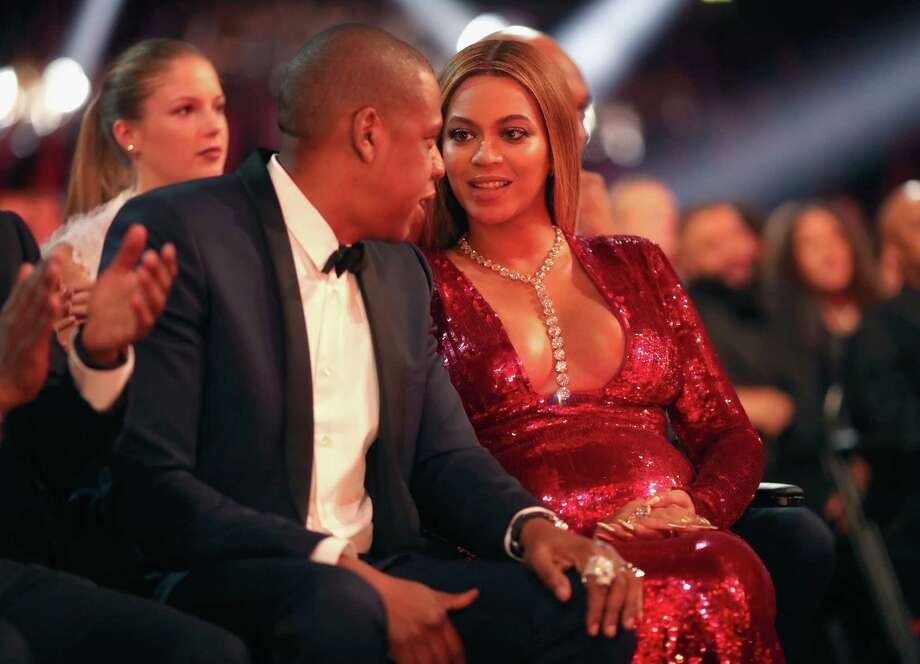 Jay-Z and singer Beyonce, who changed into atight red sequin dress by Peter Dundas after her performance. Photo: Christopher Polk, Getty Images For NARAS / 2017 Getty Images