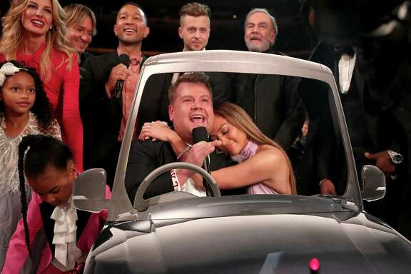 "Blue Ivy Carter, from left,  Faith Hill, Keith Urban, John Legend, Grammy host James Corden, Ryan Tedder of OneRepublic, Jennifer Lopez and Neil Diamond sing ""Sweet Caroline"" during the show."