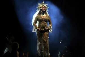"""Beyoncé, pregnant with twins, performed """"Love Drought"""" and """"Sandcastles,"""" songs off of her """"Lemonade"""" album, at the 59th annual Grammy Awards at the Staples Center in Los Angeles. She was draped in a sheer, gold, belly-hugging gown and matching headpiece."""