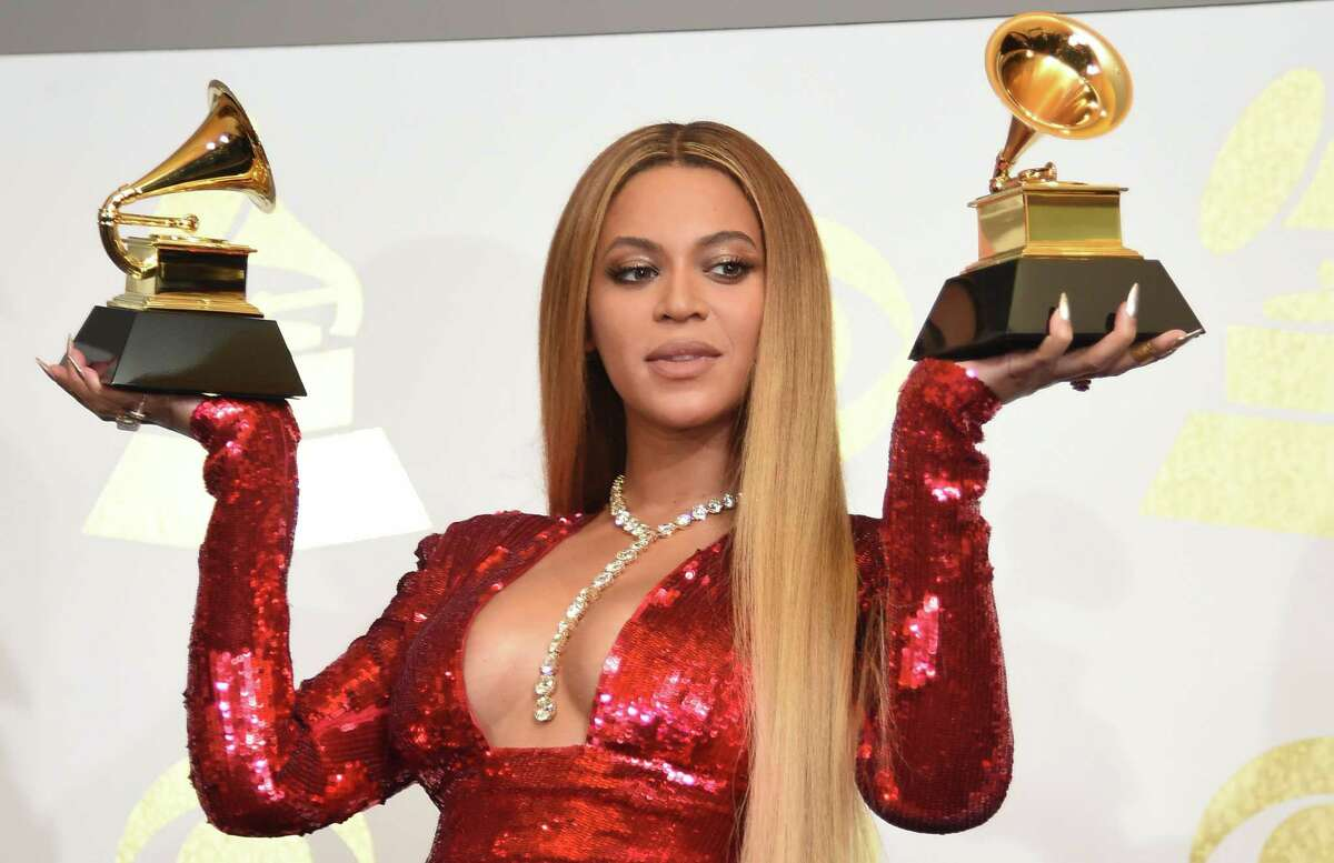 Beyoncé poses with her Grammy trophies in the press room during the 59th Annual Grammy Music Awards on February 12, 2017, in Los Angeles.