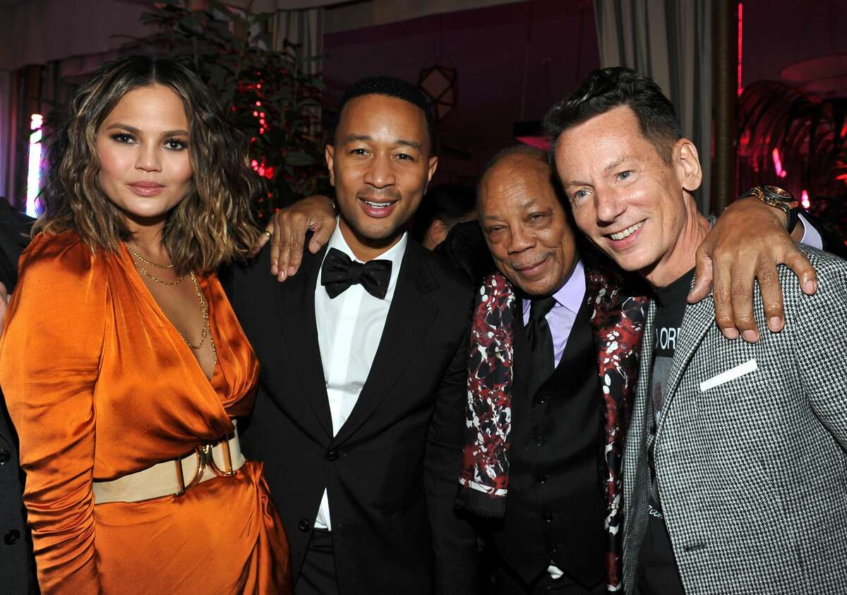 Celebs celebrate Grammy victories during after parties throughout Los Angeles (L-R) Singer-songwriter John Legend, producer Quincy Jones, model Chrissy Teigan, and GQ editor-in-chief Jim Nelson attend GQ and Chance The Rapper Celebrate the Grammys in Partnership with YouTube at Chateau Marmont on February 12, 2017 in Los Angeles, California.