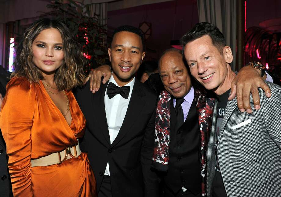 Celebs celebrate Grammy victories during after parties throughout Los Angeles(L-R) Singer-songwriter John Legend, producer Quincy Jones, model Chrissy Teigan, and GQ editor-in-chief Jim Nelson attend GQ and Chance The Rapper Celebrate the Grammys in Partnership with YouTube at Chateau Marmont on February 12, 2017 in Los Angeles, California.  Photo: Donato Sardella/Getty Images For GQ