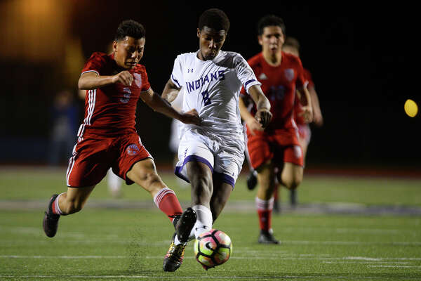 Lumberton's Emilio Beltran defends Port Neches-Groves' Kellon Hoyte during the first half of a boys soccer match at Indian Stadium on Friday evening.  Photo taken Friday 2/10/17 Ryan Pelham/The Enterprise
