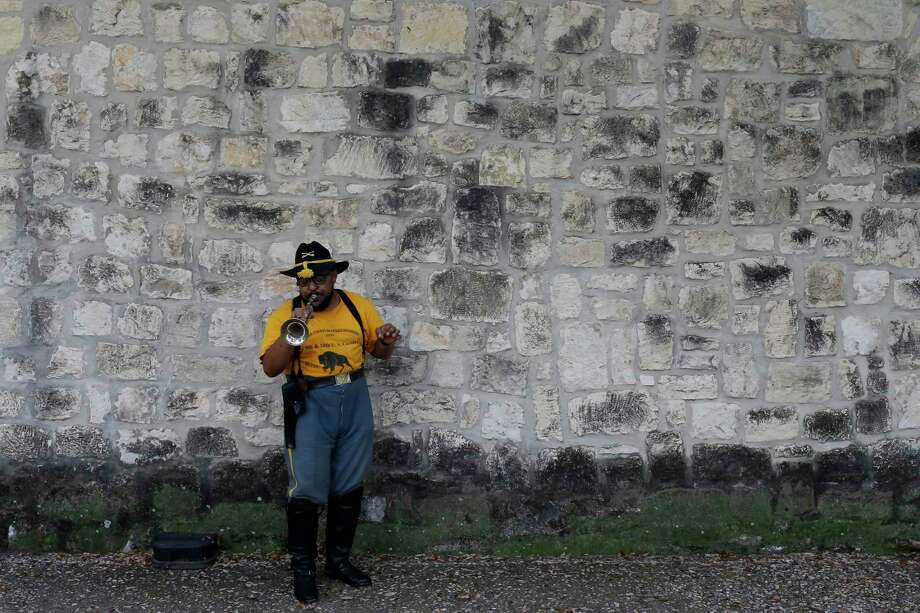 Bexar County Buffalo Soldier Dustin Mitchell practices with a bugle before the start of Buffalo Soldier Day at the University of Texas at San Antonio Institute of Texan Cultures Feb. 12. Also participating in the event were members of the Texas Parks and Wildlife Buffalo Soldiers. Photo: Jerry Lara /San Antonio Express-News / © 2017 San Antonio Express-News